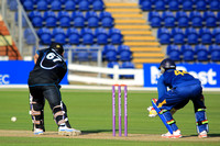 Daryl Mitchell of New Zealand and Lokuge Chandimal of Sri Lanka
